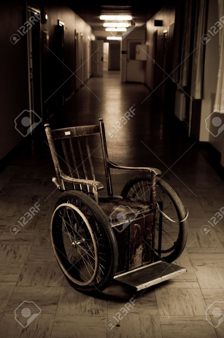 old wheelchair standing in a empty corridor Stock Photo - 3763248