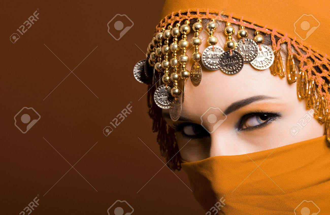 a beautiful woman wearing a red exotic veil Stock Photo - 6156327