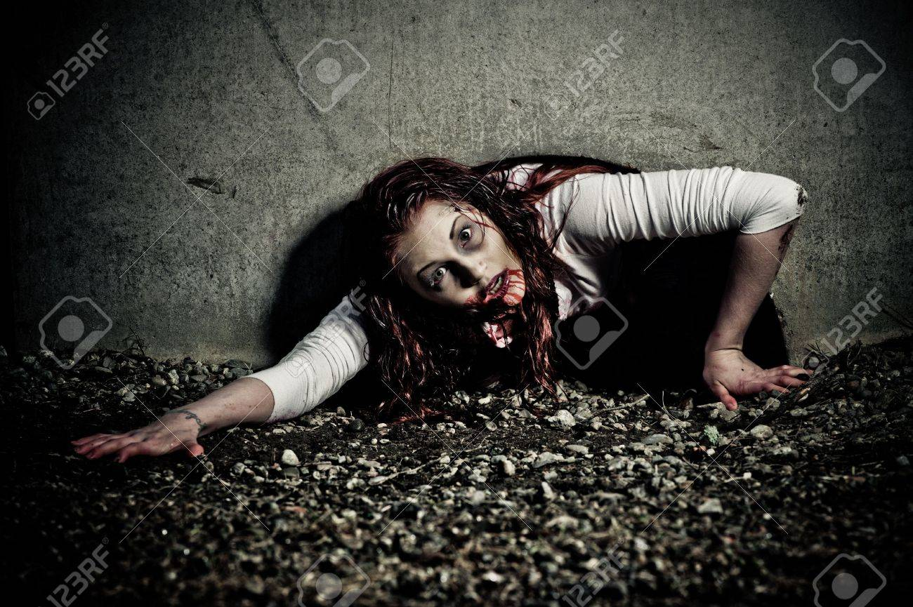 a bloody and scary looking zombie girl Stock Photo - 6959850