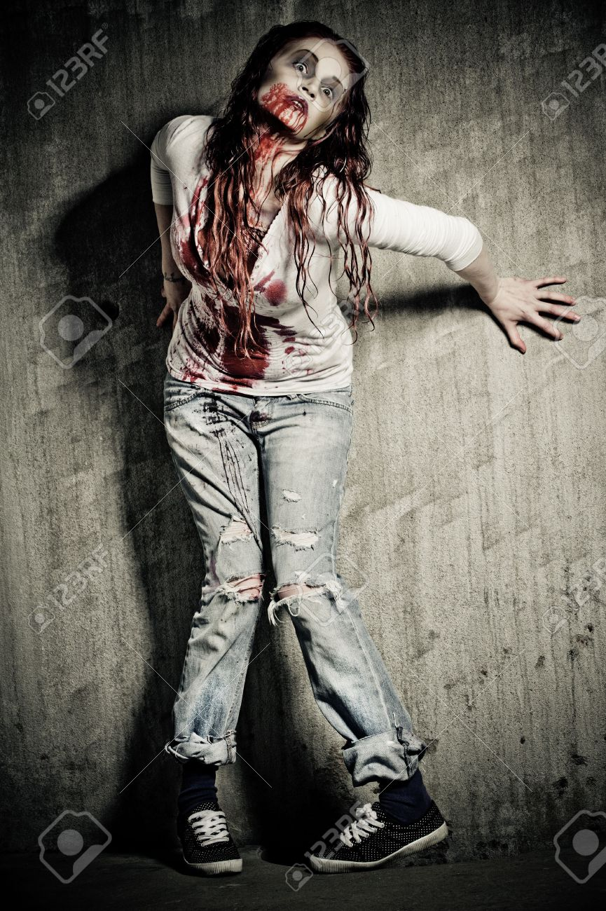 a bloody and scary looking zombie girl Stock Photo - 6959873