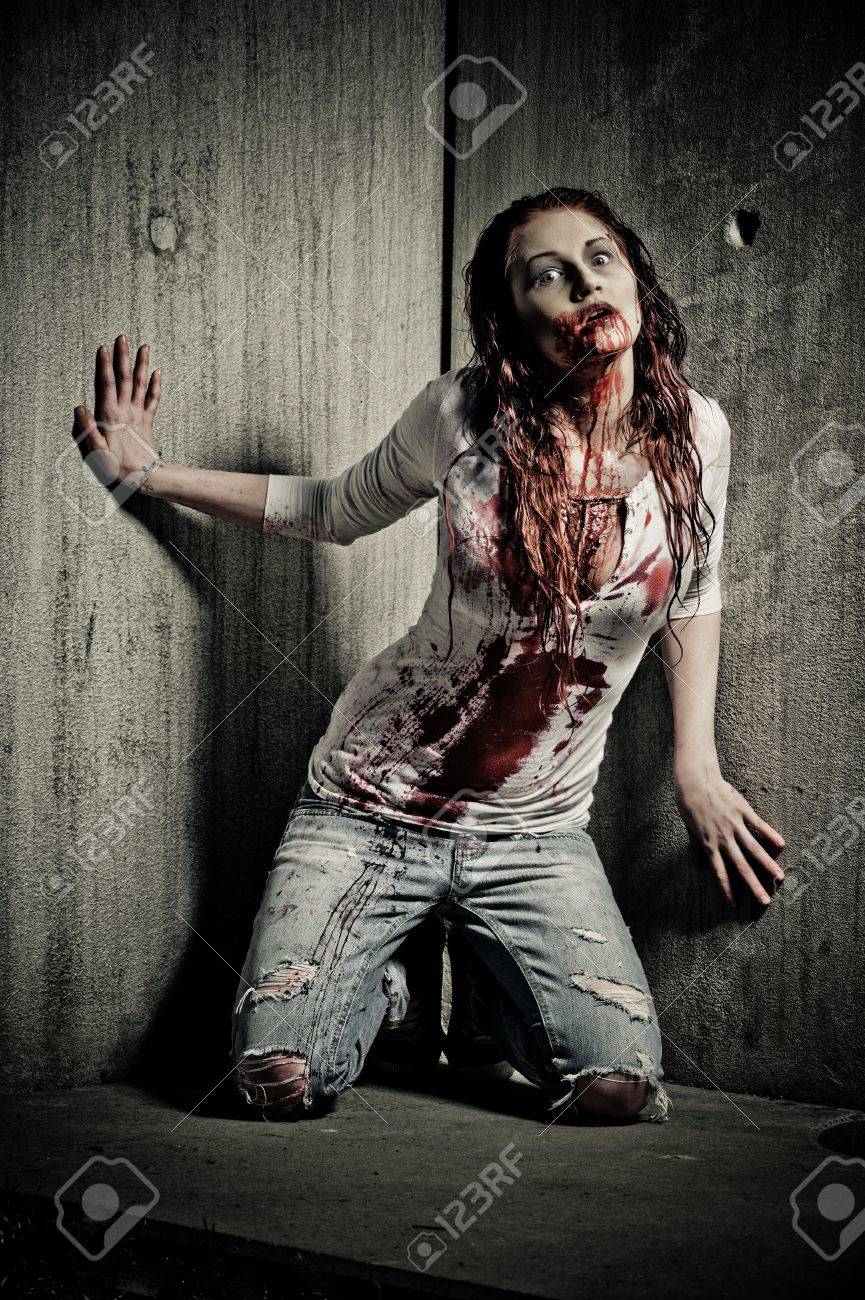 a bloody and scary looking zombie girl Stock Photo - 6976702