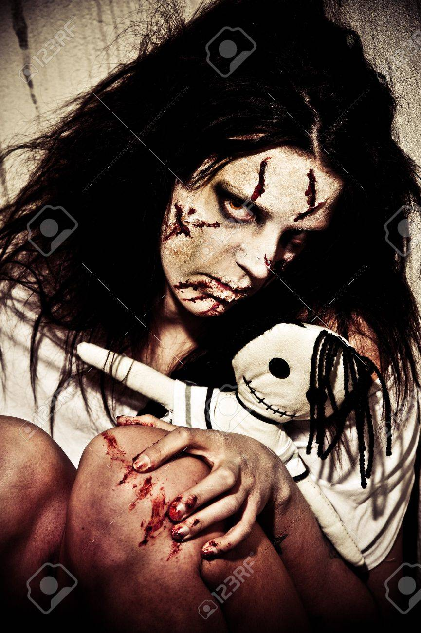a scary looking girl possessed by a demon Stock Photo - 7853486