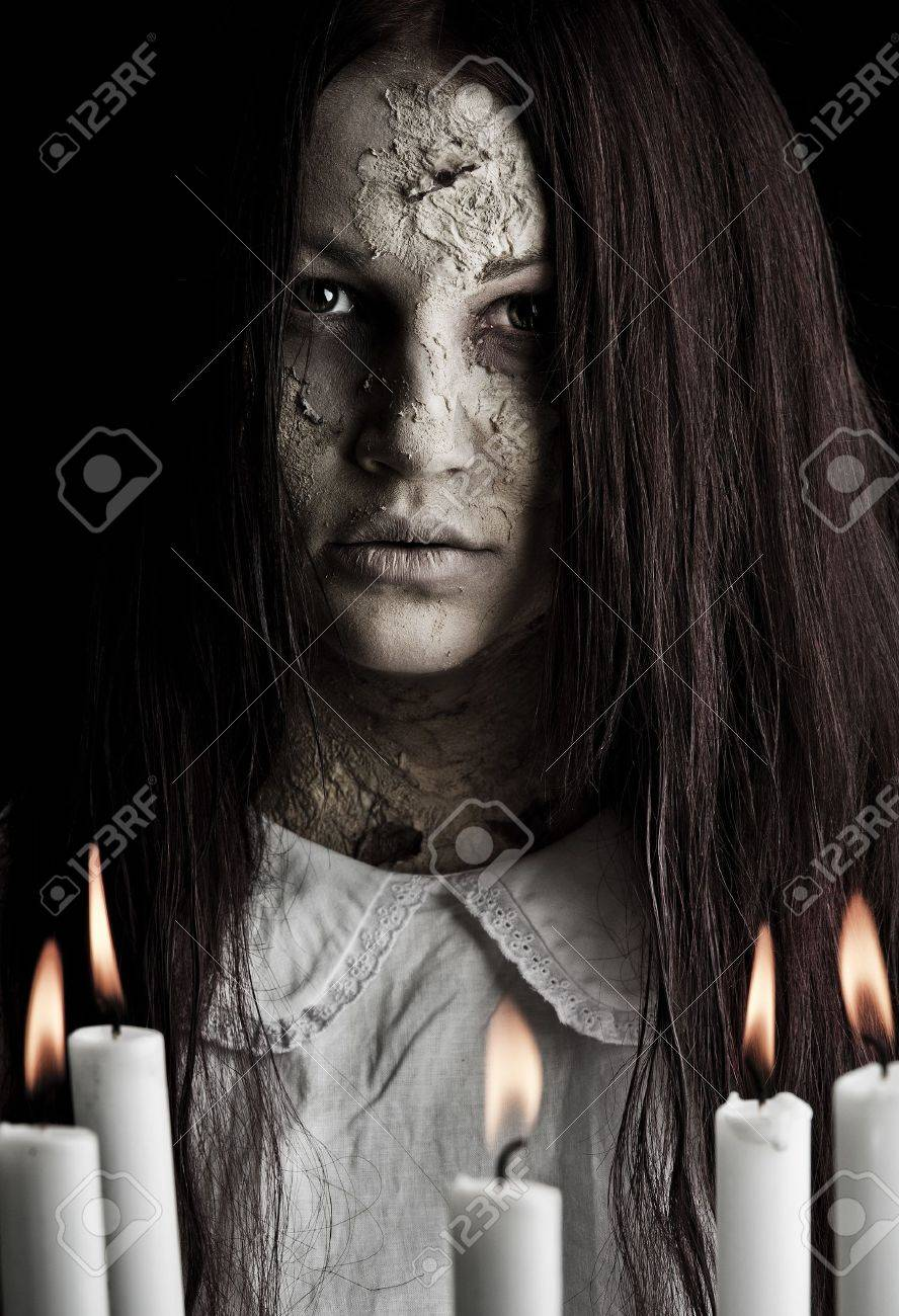a scary ghost girl wearing a white nightie Stock Photo - 8381297