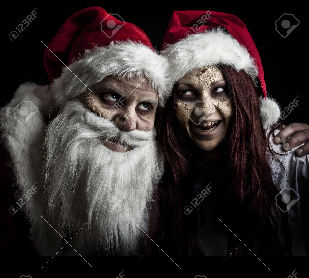 portrait of a scary looking santa claus and an elf Stock Photo - 8381299