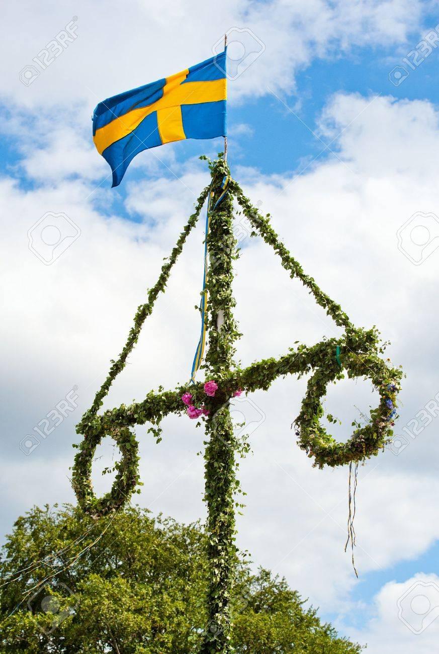 a traditional swedish midsummer pole with a swedish flag Stock Photo - 9986049