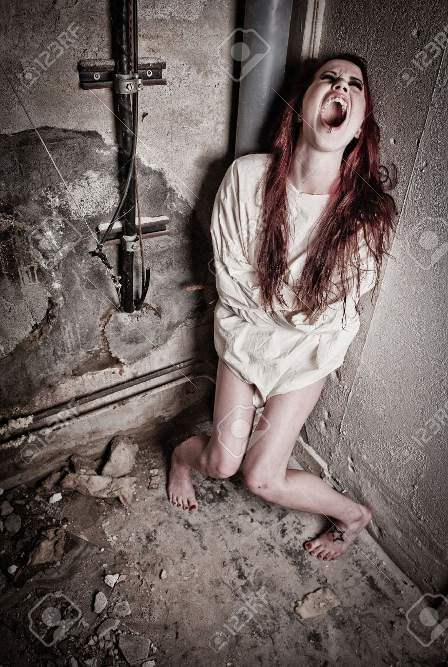 An Insane Psycho Girl Wearing A Straight Jacket Stock Photo