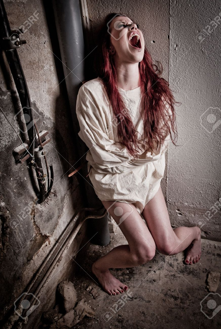 an insane psycho girl wearing a straight jacket Stock Photo - 10312273