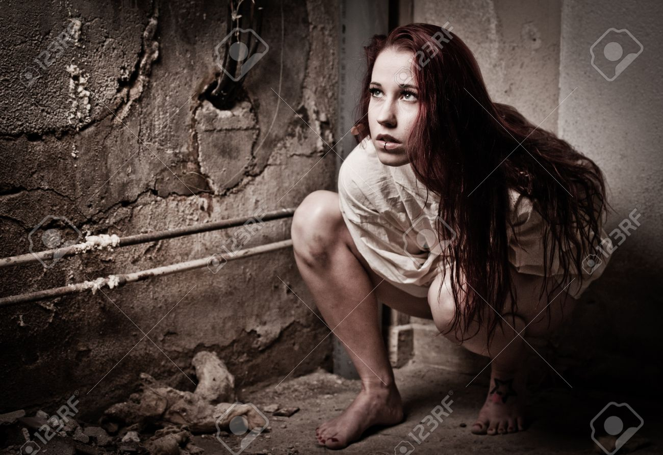 An Insane Psycho Girl Wearing A Straight Jacket Stock Photo ...