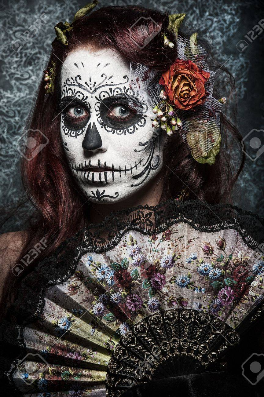 a woman with her face painted as a traditional day of the dead sugarskull mask Stock Photo - 12516740