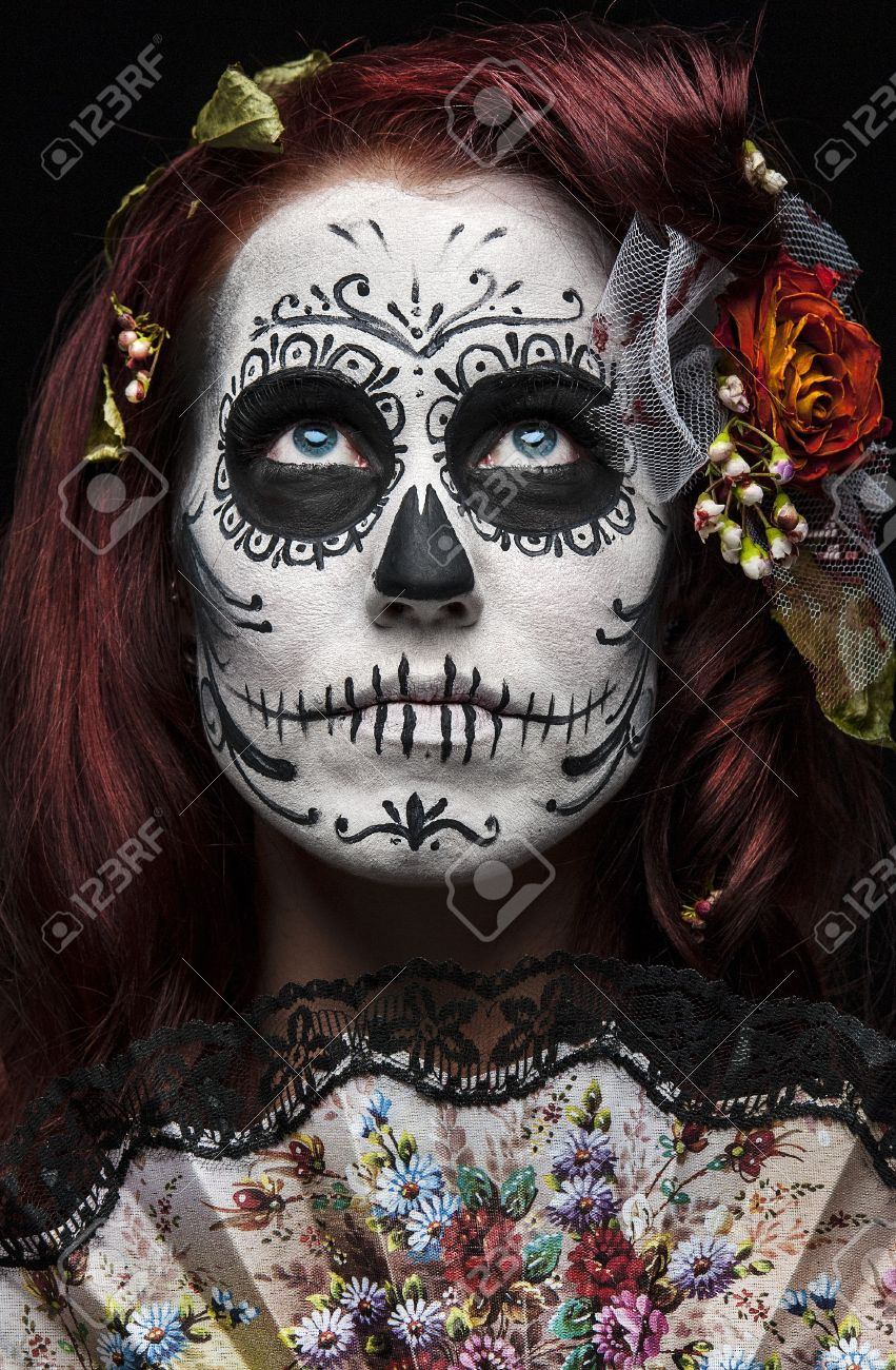 a woman with her face painted as a traditional day of the dead sugarskull mask Stock Photo - 12516718