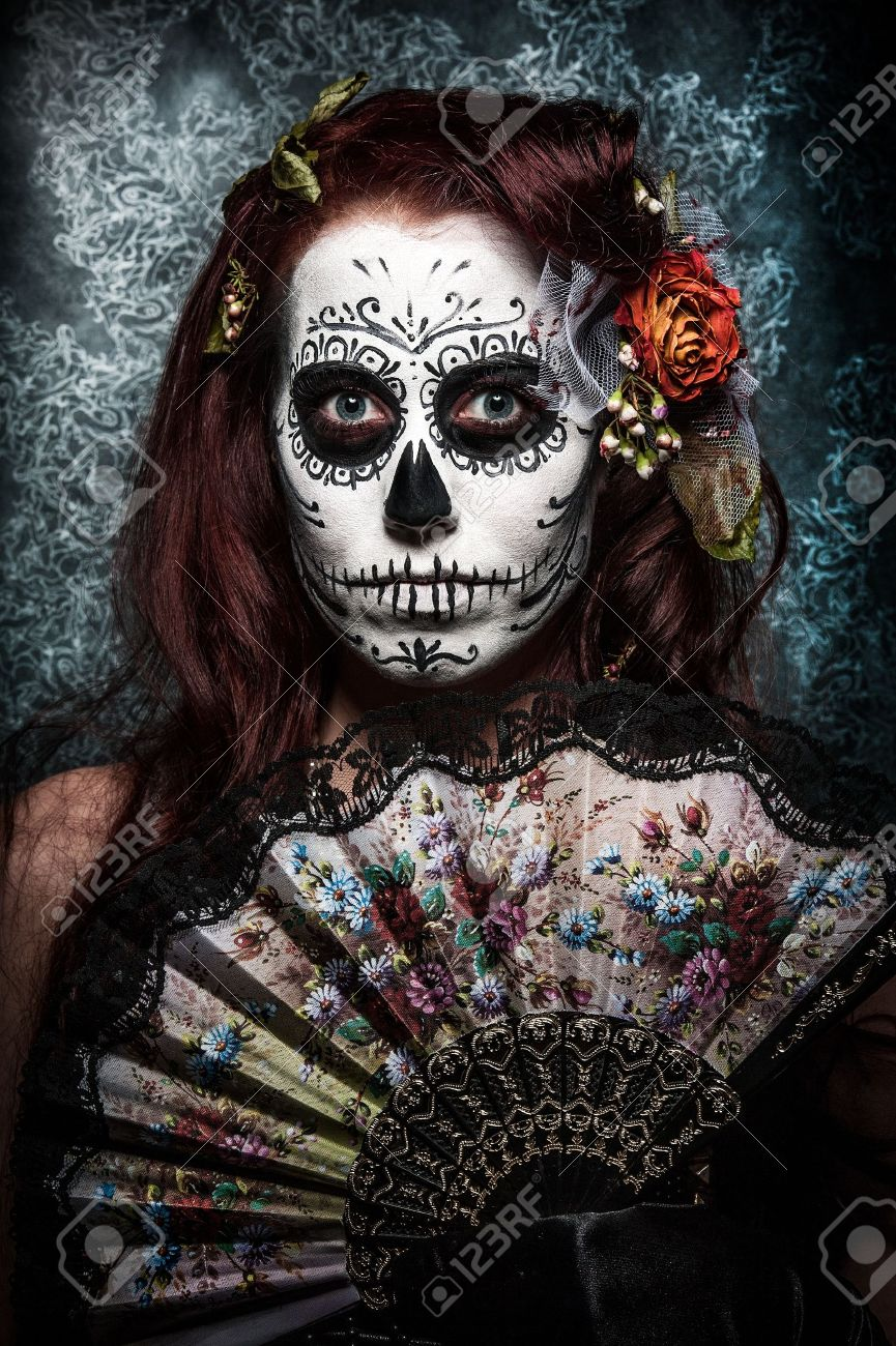 a woman with her face painted as a traditional day of the dead sugarskull mask Stock Photo - 12517708