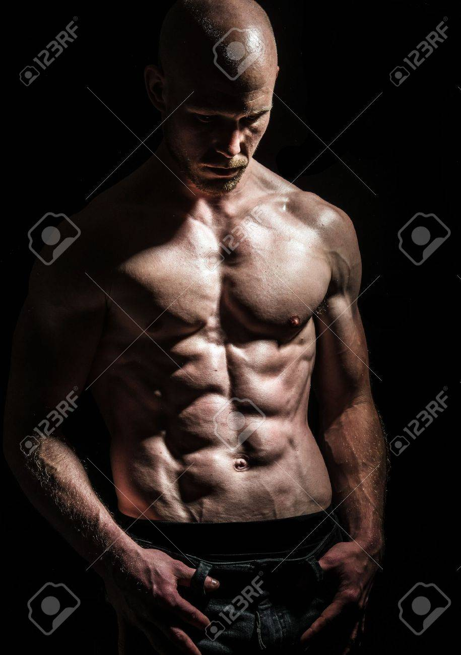 a young fit athlete posing his ripped body Stock Photo - 14454371