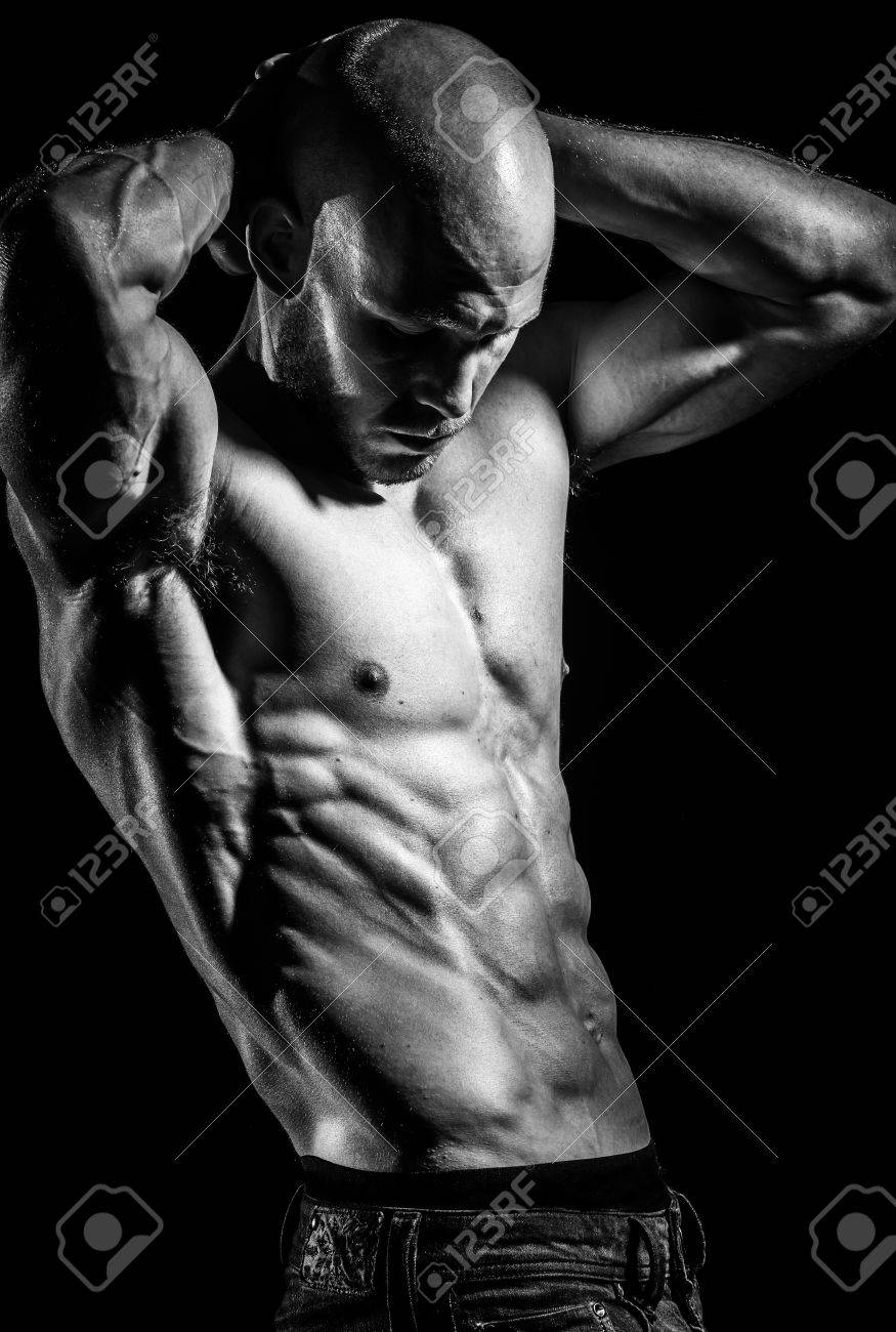 a young fit athlete posing his ripped body Stock Photo - 14454373