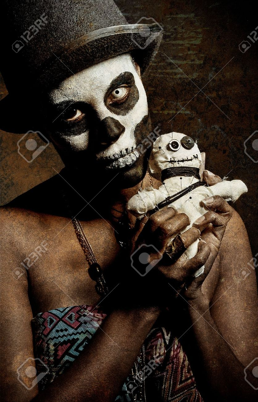 A Female Voodoo Priestess With Face Paint Stock Photo, Picture And