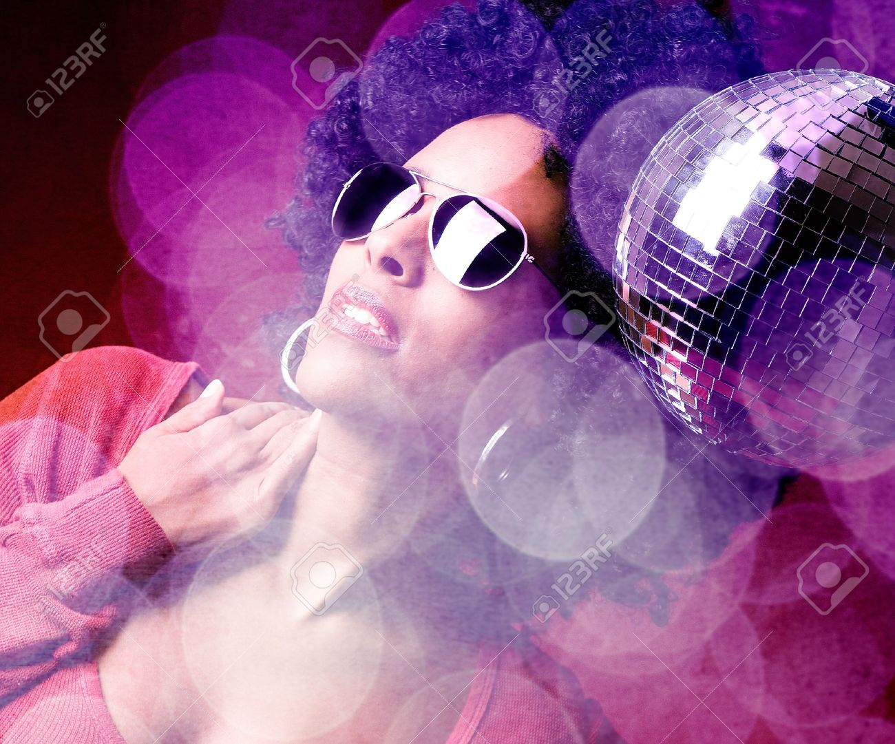 70s disco girl with a disco ball and a big afro hair Stock Photo - 17577105