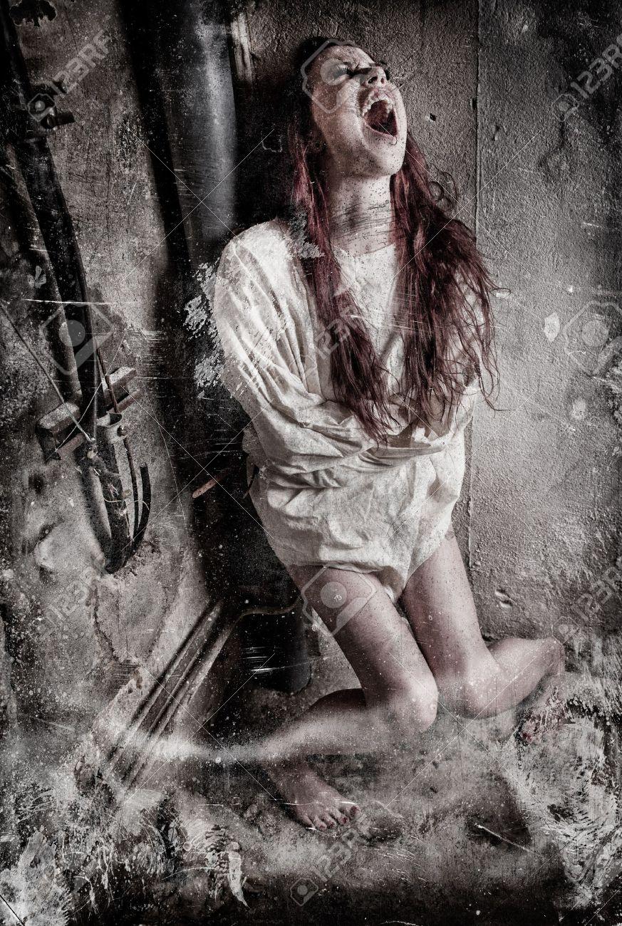 an insane psycho girl wearing a straight jacket Stock Photo - 17664274