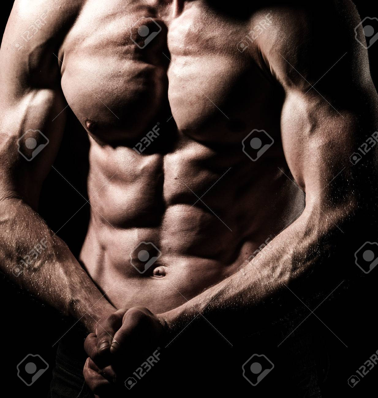 A Very Fit Male Flexing His Muscular Chest Stock Photo Picture And