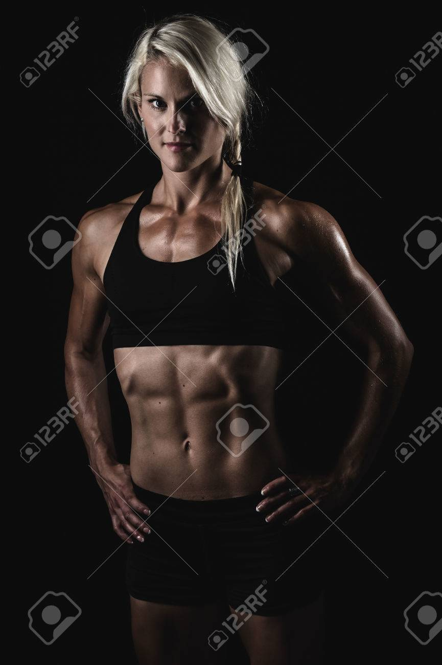a young and very fit woman flexing her muscles Stock Photo - 23523267