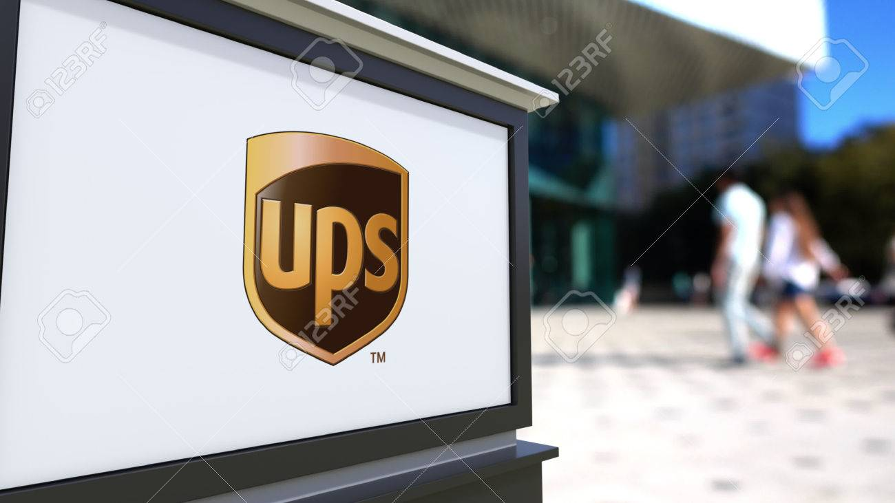 Street signage board with united parcel service ups logo. blurred