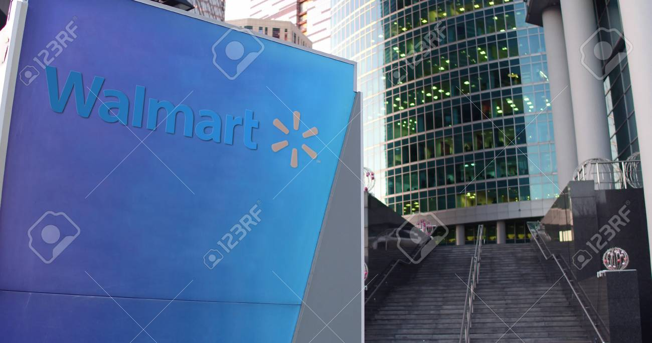 Street signage board with walmart logo modern office center