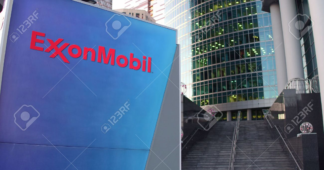 Exxon stock photos royalty free business images street signage board with exxonmobil logo modern office center skyscraper and stairs background editorial buycottarizona Gallery