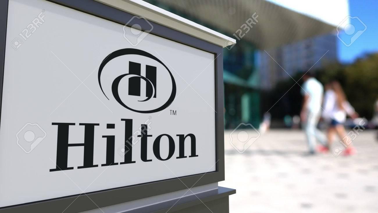 Street Signage Board With Hilton Hotels Resorts Logo Blurred