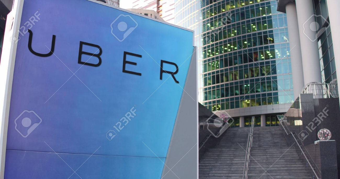 Street signage board with uber technologies inc logo modern