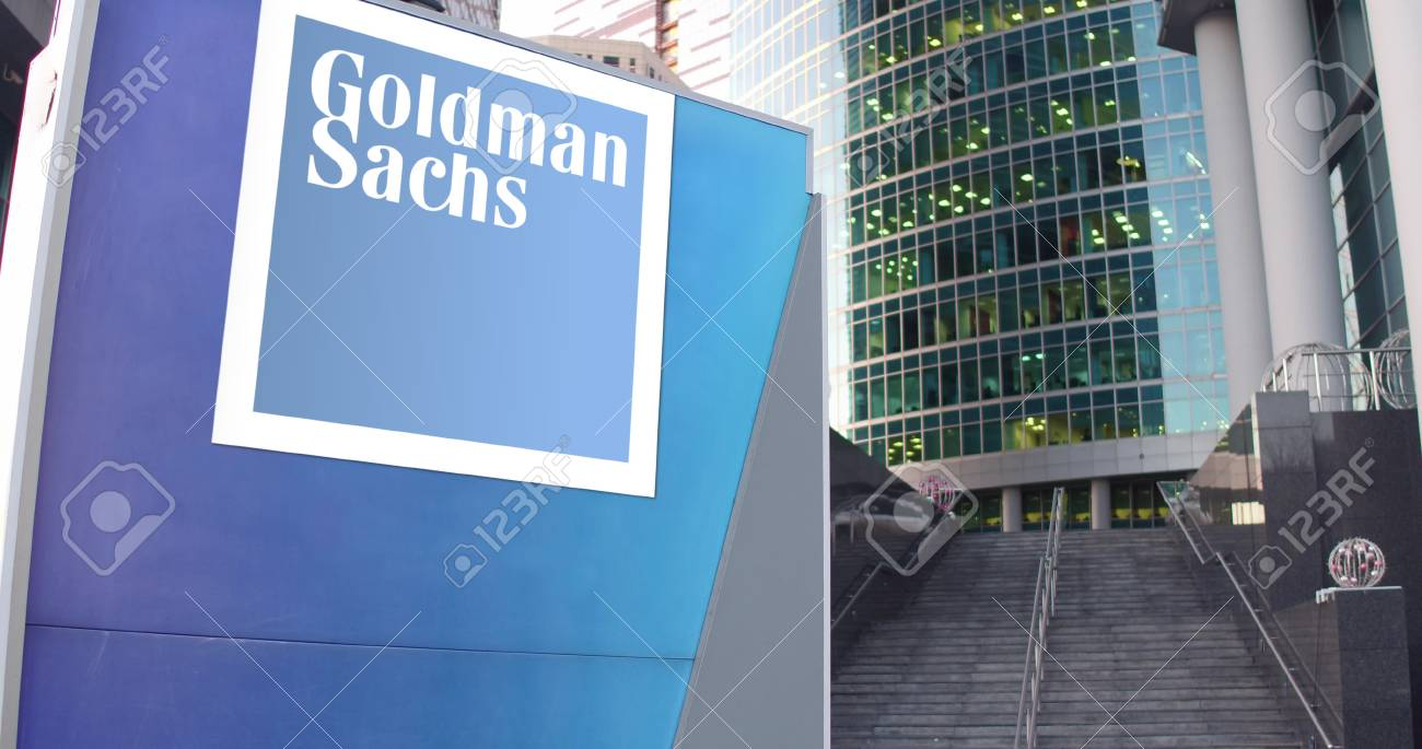Street signage board with The Goldman Sachs Group, Inc. logo. Modern office center skyscraper and stairs background. Editorial 3D rendering - 72053270