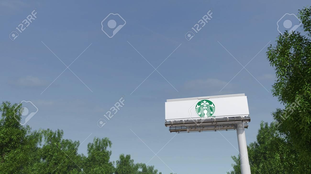 Driving Towards Advertising Billboard With Starbucks Logo Editorial