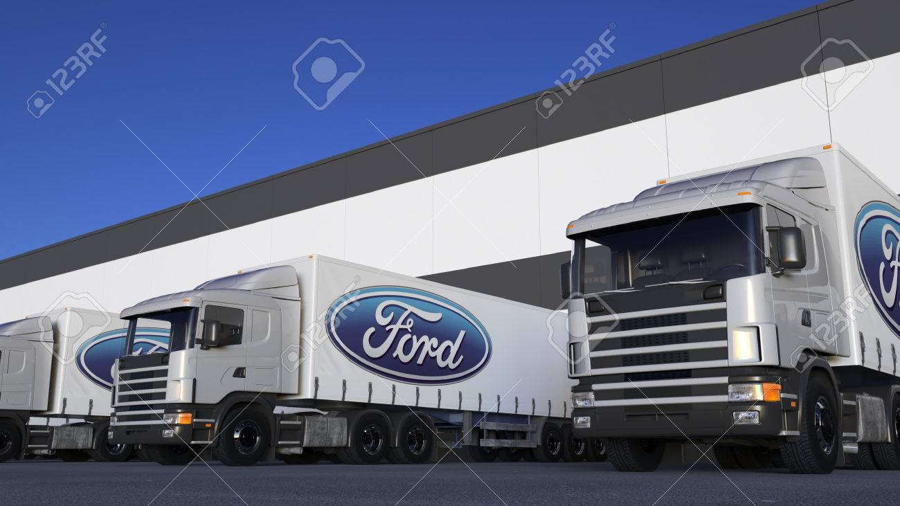 Freight semi trucks with Ford Motor Company logo loading or unloading