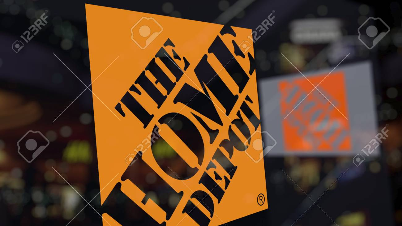 The Home Depot logo on the glass against blurred business center