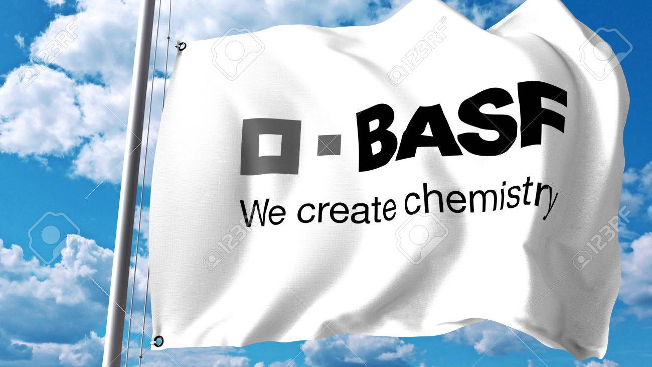 Waving Flag With Basf Logo Against Clouds And Sky Editorial Stock