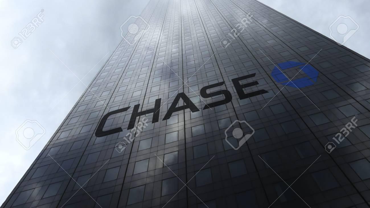 JPMorgan Chase Bank logo on a skyscraper facade reflecting clouds