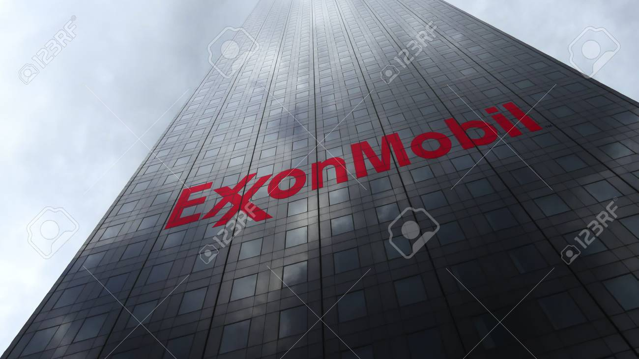 ExxonMobil logo on a skyscraper facade reflecting clouds  Editorial