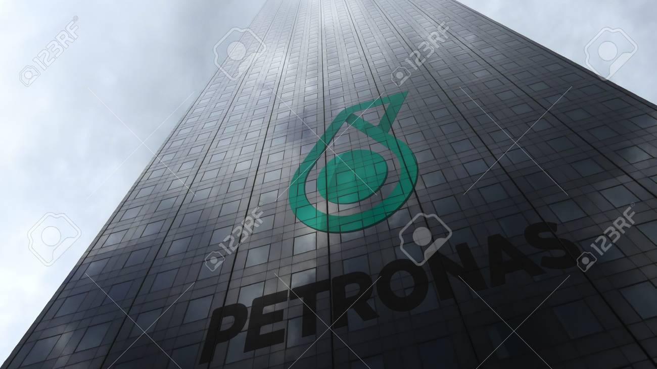 Petroliam nasional berhad petronas logo on a skyscraper facade petroliam nasional berhad petronas logo on a skyscraper facade reflecting clouds editorial 3d rendering stock buycottarizona Gallery