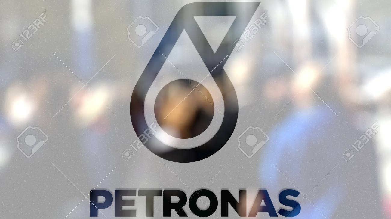 Petroliam nasional berhad petronas logo on a glass against blurred petroliam nasional berhad petronas logo on a glass against blurred crowd on the steet editorial buycottarizona Gallery