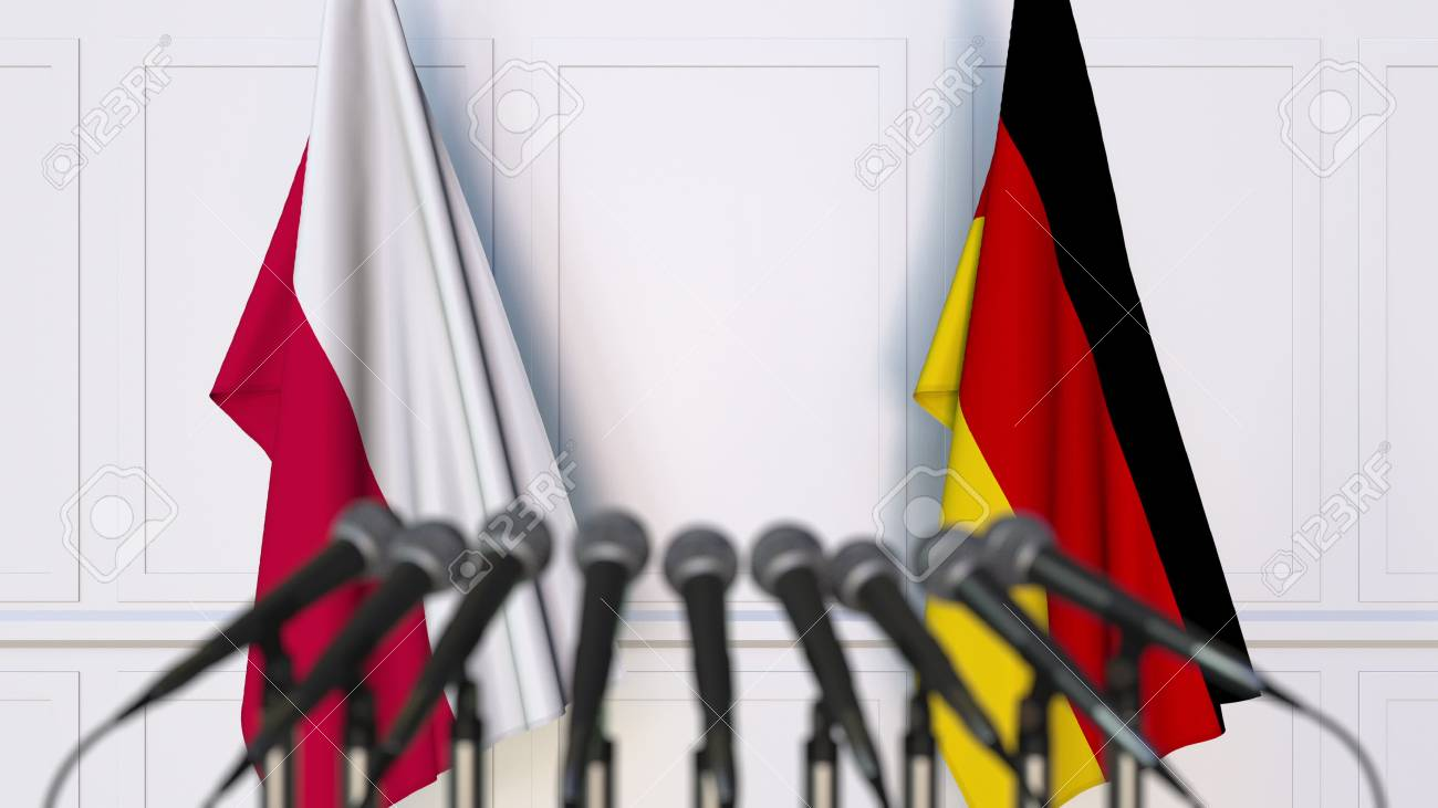 Flags of Poland and Germany at international meeting or conference