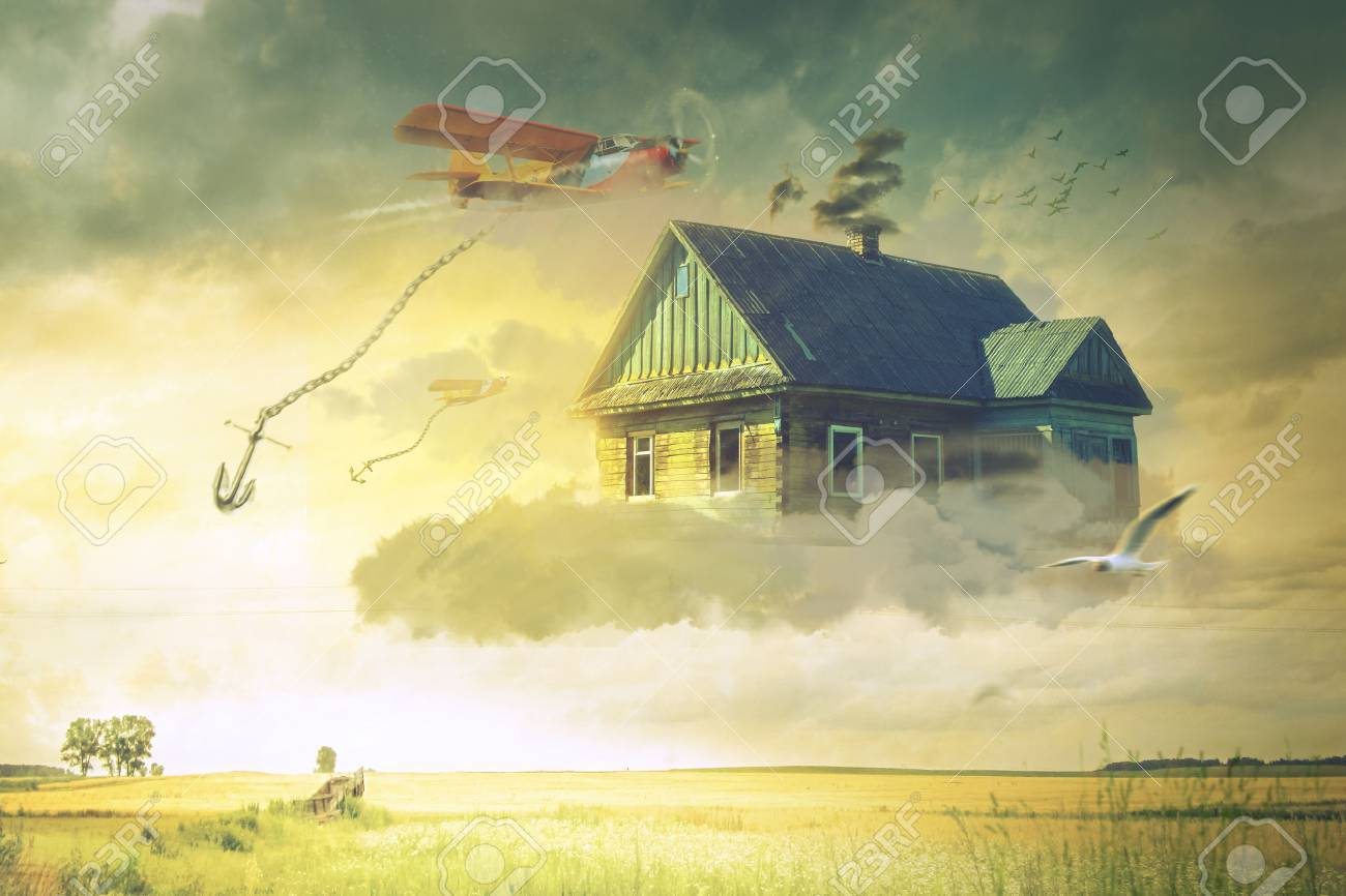The house in the clouds hovering above the ground Stock Photo - 73002947