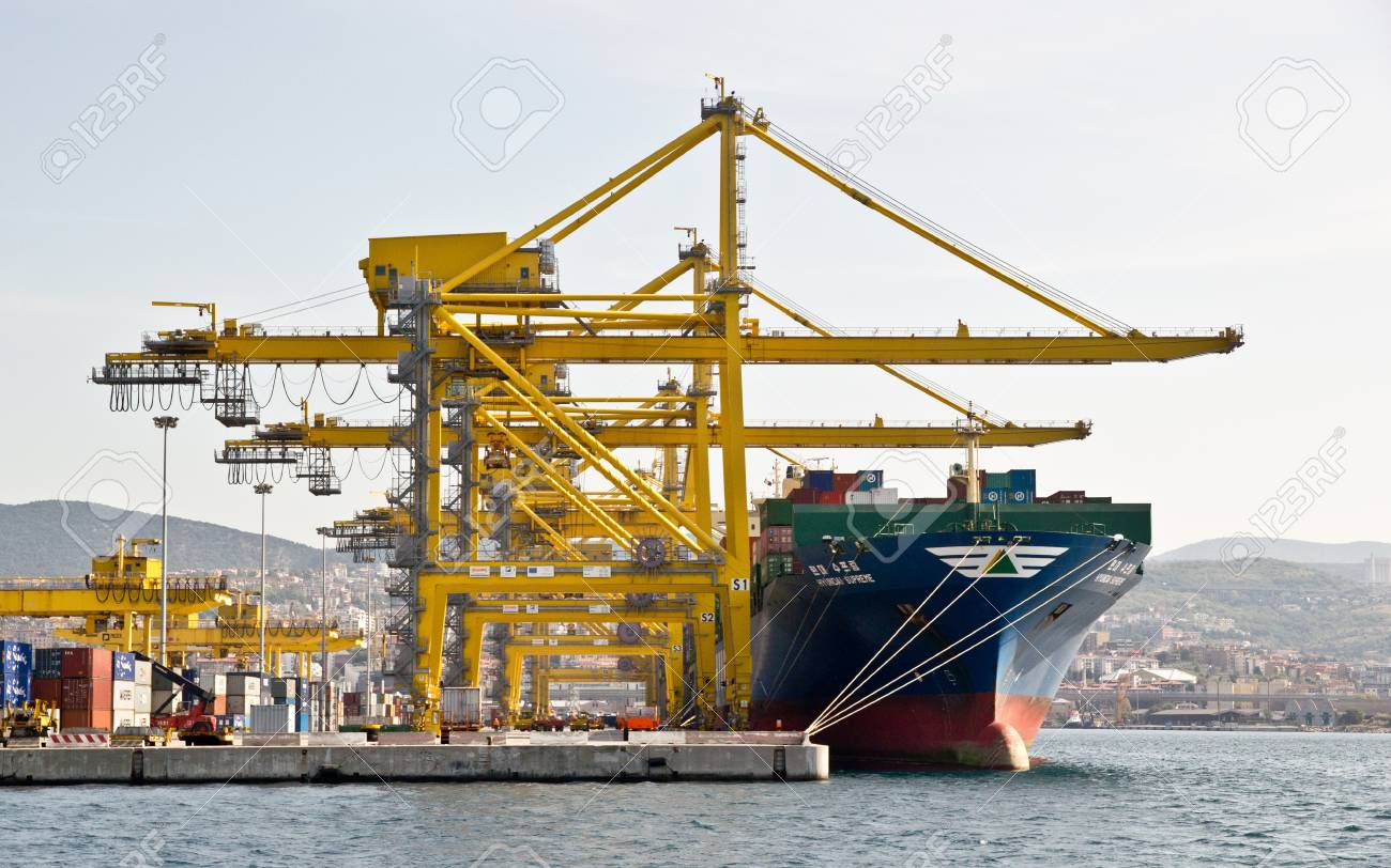 Trieste, ITA - 2 july 2011: Wiew of the port of Trieste to the sea with ship for transporting containers. Stock Photo - 13072938