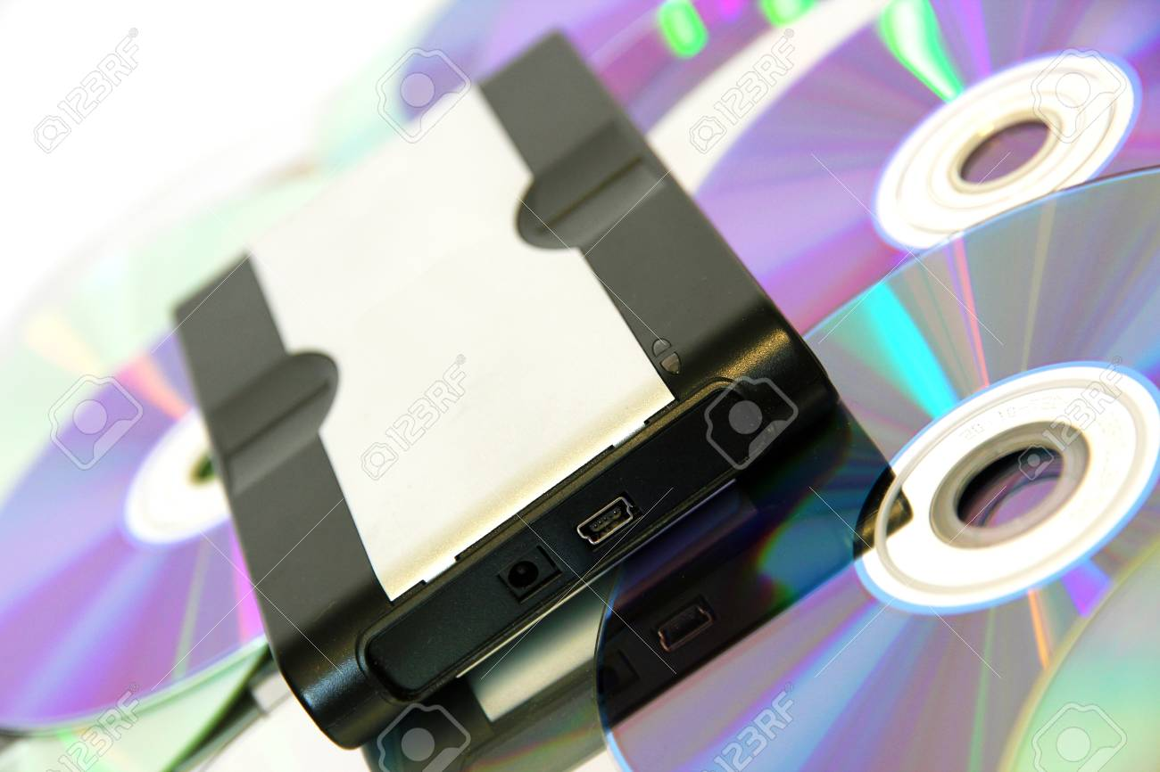 Hard Disk on CDs and DVDs, the innovation Stock Photo - 13128966