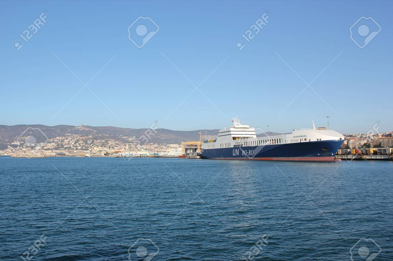 Trieste, ITA - 2 july 2011: Wiew of the port of Trieste to the sea with ship for transporting containers. Stock Photo - 13182861
