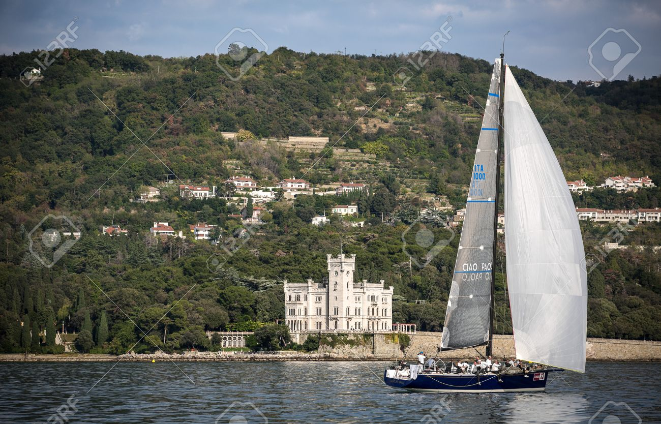 sailboat during a race in the Gulf of Trieste with Miramare castle during Barcolana 2012 Stock Photo - 15838455