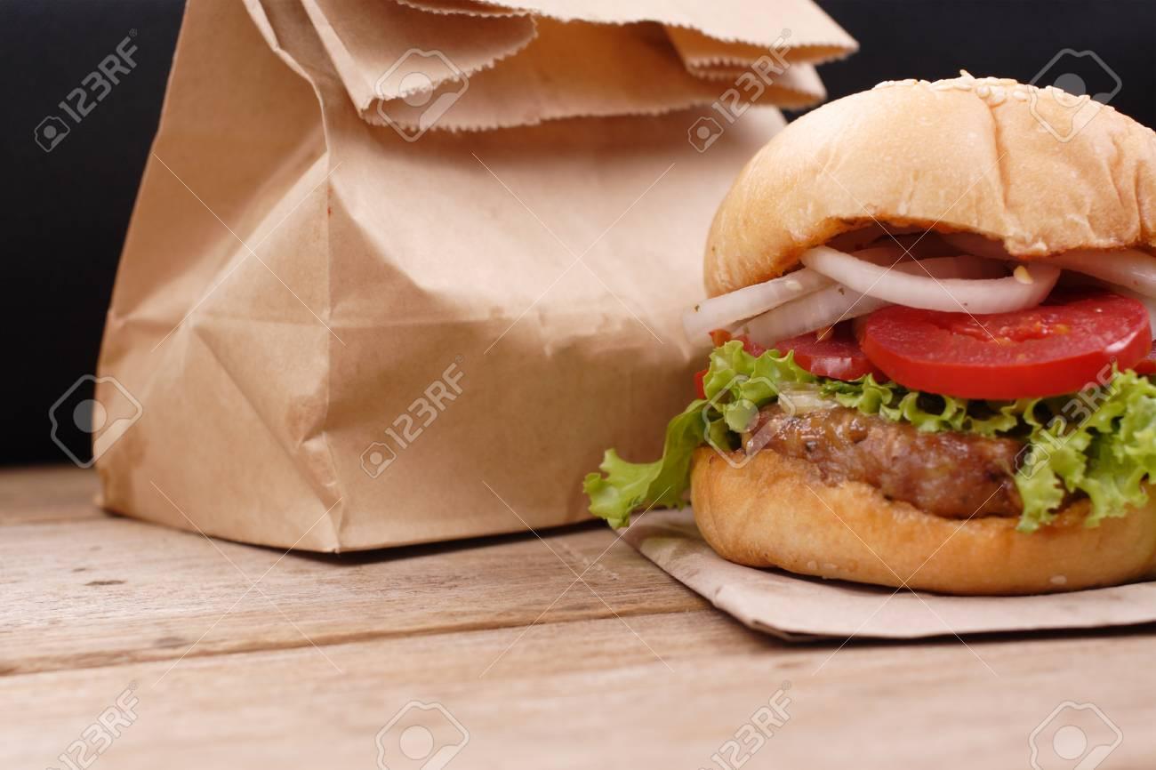 Hamburgers on wooden background - 64788757