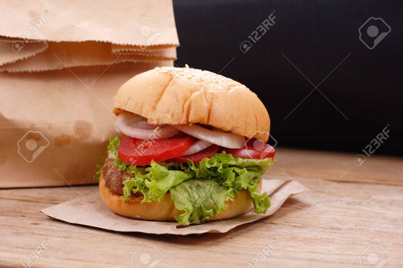 Hamburgers on wooden background - 64788961