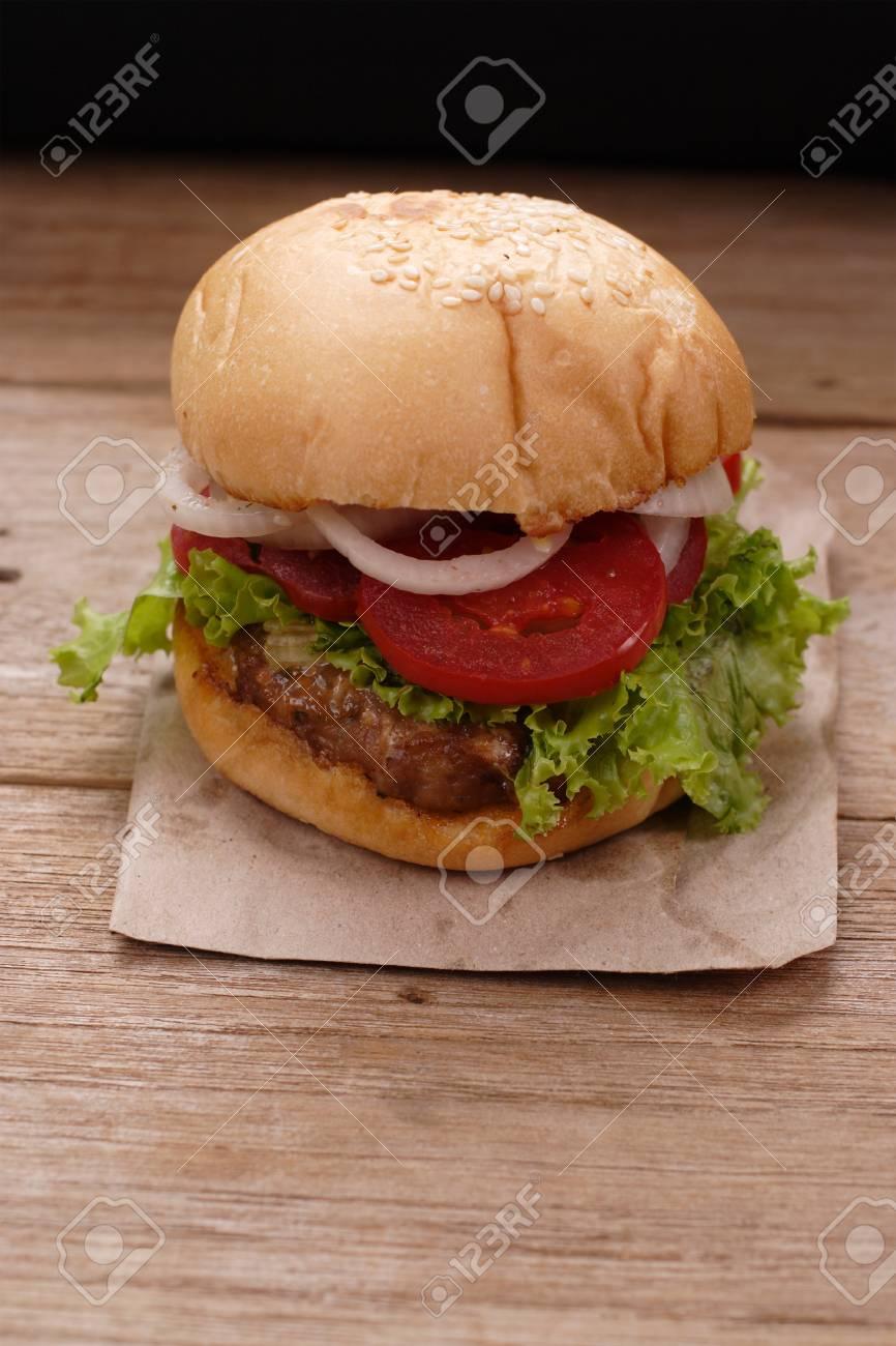 Hamburgers on wooden background - 64788977