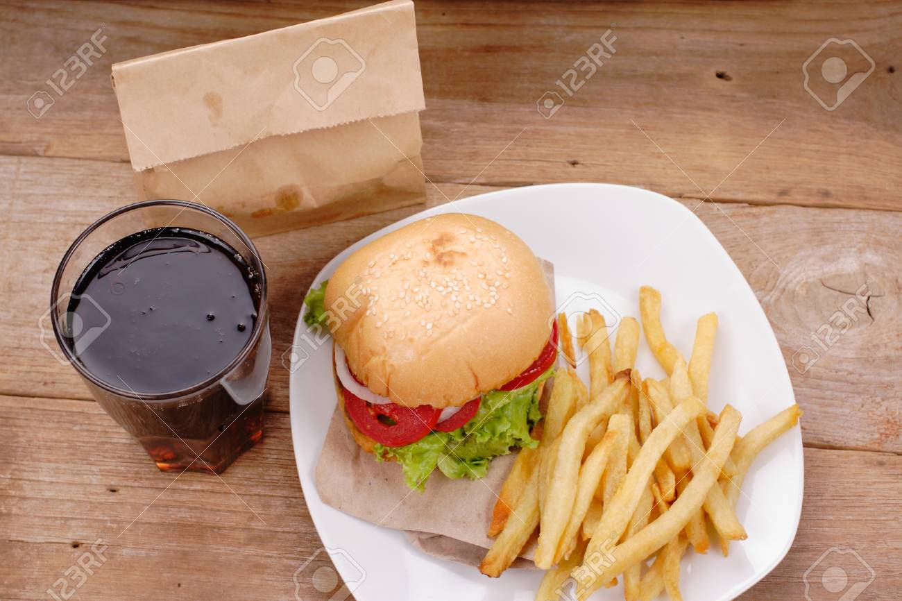 hamburger and french fries on wooden background - 64789865