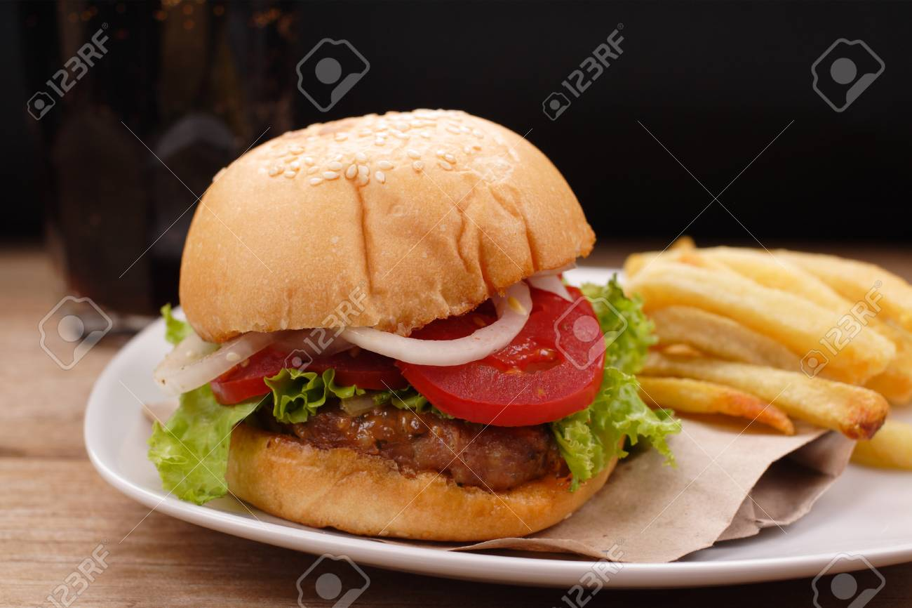 hamburger and french fries on wooden background - 64789877