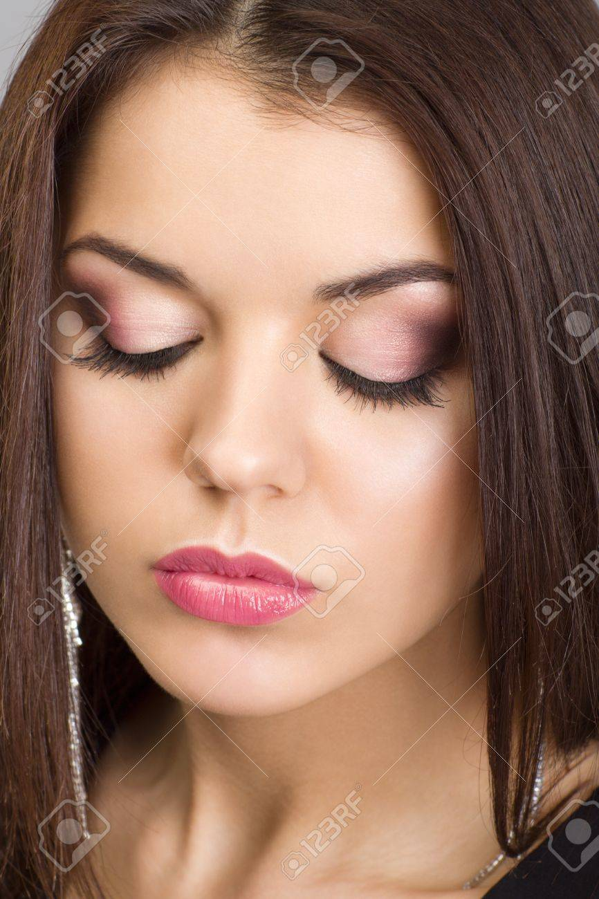 Portrait of a beautiful woman with evening make-up and earrings Stock Photo - 19036657