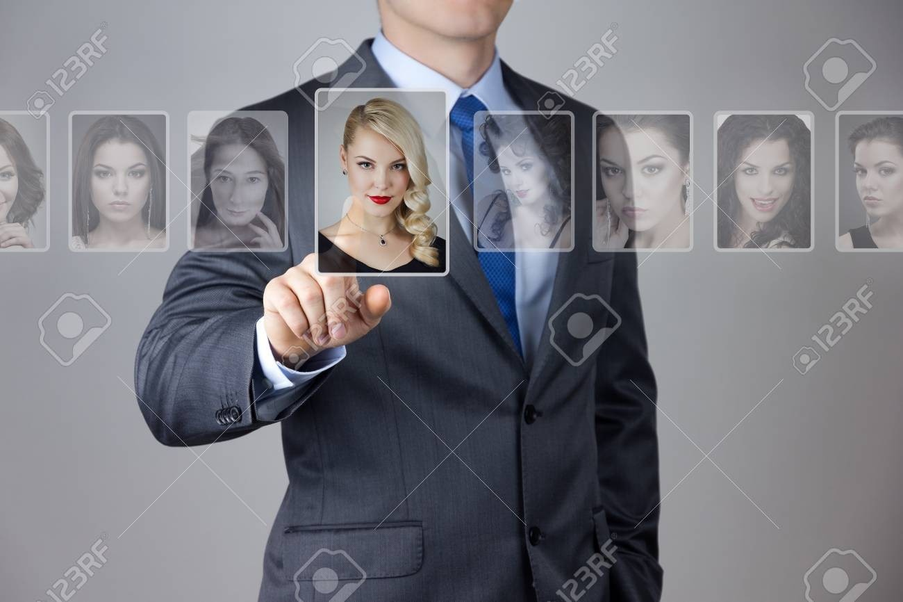 Man making a choise of woman at introduction service Stock Photo - 23877196