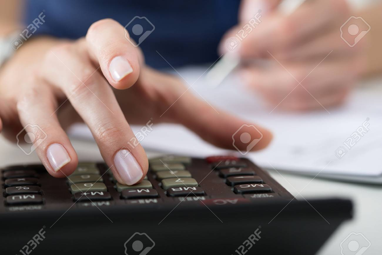 Close up of female accountant or banker making calculations. Savings, finances and economy concept - 46777695